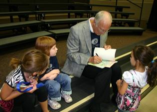 David Harrison Signs Books, Children Watching.