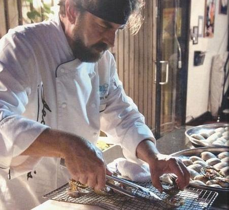 Irv Miller shows his expertise with shellfish.